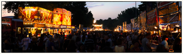 The midway on a sumer evening at the Lisle Eyes to the Sky Festival
