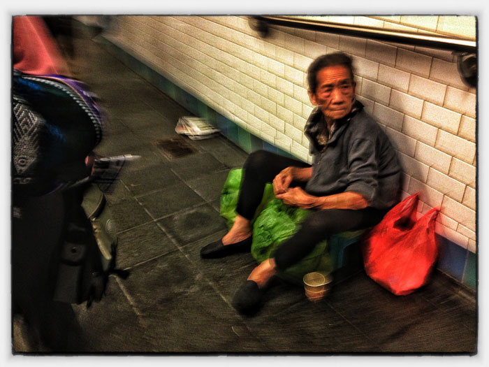 Asking for money in the NYC subway